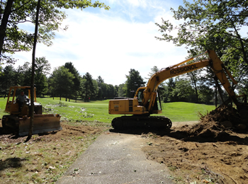 Expanding the green space at the Waterville Country Club, by Rossignol's Excavating.