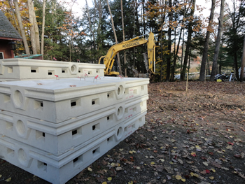 Heavy duty concrete septic system chambers waiting to be installed by Rossignol's Excavating.