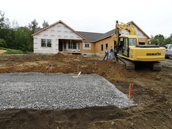 Crushed rock drain field for a Residential Septic System by Rossignol's Excavating.