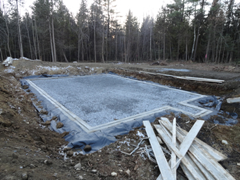 Footings and drainage, ready for foundation walls by Rossignol's Excavating.